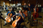 Cellist Steve Erdody rehearses with the cellos and basses
