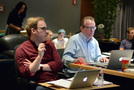 Alan Menken's music assistant Aaron Kenny and music editor Christopher Brooks work on a cue