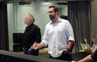 Alan Menken listens as his fellow composer Chris Lennertz gives feedback from the booth