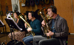 French hornists Jenny Kim, Dan Kelley, and Steve Becknell perform on Wagner tubas