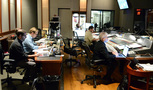 The music team hard at work in the booth: composer Chris Lennertz, Alan Menken's music assistant Aaron Kenny, stage recordist Tom Hardisty (rear, partially obscured), scoring mixer Frank Wolf, and composer Alan Menken