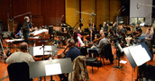 Conductor Michael Kosarin and the orchestra