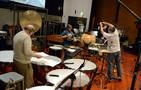 Percussionists Don Williams, Brian Kilgore, and Wade Culbreath prepare for sound check