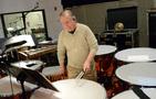 Percussionist Don Williams performs on timpani