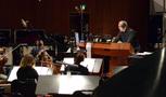 Conductor Michael Kosarin at the podium