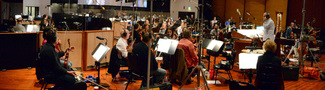 Conductor Michael Kosarin and the orchestra perform