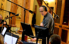 Composer and conductor Jeff Beal prepares to record
