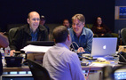 Music editors Jim Harrison and Jeff Carson talk with director Mike Thurmeier