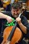 Cellist Armen Ksajikian attempts to adjust his finger