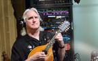 Guitarist George Doering performs on mandolin