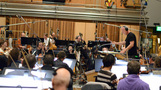 The orchestra and composer/conductor John Debney record a cue