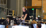 Composer/conductor John Debney watches the playback