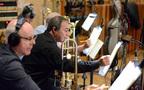 Trombonists Alex Iles and Alan Kaplan make an edit to their parts