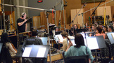 Composer/conductor John Debney records his score to <i>Ice Age: Collision Course</i> with the orchestra