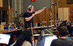 Composer/conductor John Debney records with the orchestra