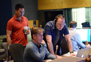 Directors Galen Chu and Mike Thurmeier listen to a cue with music editor Jeff Carson