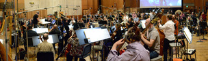 The orchestra records with composer/conductor John Debney