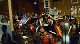 The cellos and basses get a chance to watch the playback
