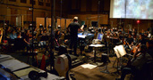 Composer John Debney prepares to give the down beat