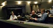 Supervising orchestrator Kevin Kaska, composer John Debney, and scoring mixer Simon Rhodes go over a cue