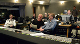 Composer John Debney (center, with score) and the rest of the music team share a laugh