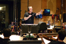 Composer/conductor John Debney cues the orchestra