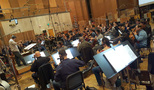 Carl Johnson conducts the Hollywood Studio Symphony strings on <em>The Magnificent Seven</em>