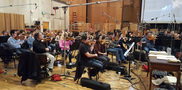 The violins and violas perform on <em>The Magnificent Seven</em>