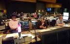 Music editor Joe E. Rand, composer Simon Franglen and scoring mixer Simon Rhodes listen to a cue