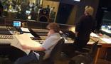 Scoring mixer Simon Rhodes and composer Simon Franglen listen to a cue