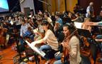The violins prepare for the next cue