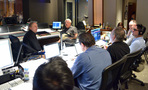 Composer Mark Mancina and orchestrator Dave Metzger talk with the rest of the team
