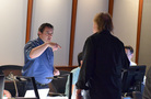 Music production director Andrew Page talks with composer Mark Mancina