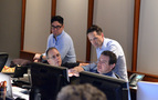 Music technical consultant Marlon Espino, music editor Earl Ghaffari (seated, left), music editor Dan Pinder (standing, right), and music production director Andrew Page discuss a cue
