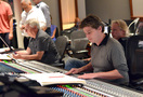 Orchestrator Dave Metzger and scoring mixer Dave Boucher review the score