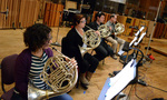 The French horn section performs on a cue from <i>Of Kings and Prophets</i>