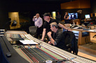 Composer Trevor Morris and recording mixer Jim Hill check the mix with playback