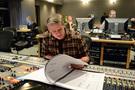Recording mixer Jim Hill checks the score