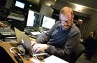 Score mixer Phil McGowan checks his notes