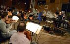 Composer/conductor Trevor Morris recording the score