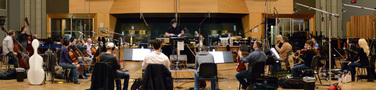 The orchestra records a cue for <i>Of Kings and Prophets</i> with composer/conductor Trevor Morris