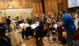 Composer and conductor Chris Lennertz and the orchestra