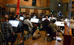 Composer and conductor Chris Lennertz records with the Hollywood Studio Symphony