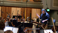 Composer and conductor Chris Lennertz records a cue with the orchestra from his score to <i>Ride Along 2</i>