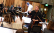 Concertmaster Mark Robertson talks with his section