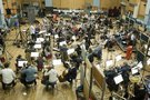 Christopher Lennertz conducts the orchestra