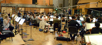 The Hollywood Studio Symphony performs a cue from <i>Sing</i> with conductor Mark Graham