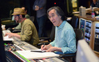 Composer Michael Giacchino goes over the score as scoring mixer Joel Iwataki makes notes