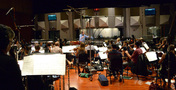 Conductor/orchestrator Nicholas Dodd records a cue to <em>Storks</em>