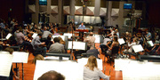 The orchestra prepares to record with conductor/orchestrator Nicholas Dodd